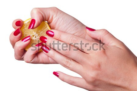 Manicured nails caress dark pink flower pedals Stock photo © juniart