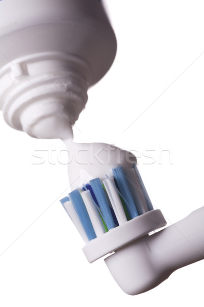 Close up of electric toothbrush and paste on white Stock photo © juniart