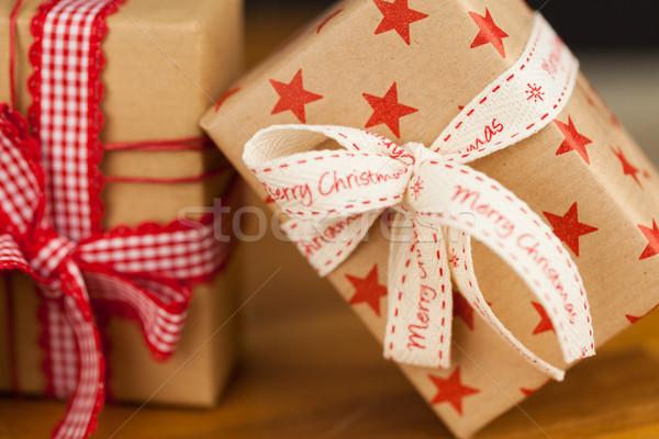Christmas presents in kraft paper Stock photo © juniart