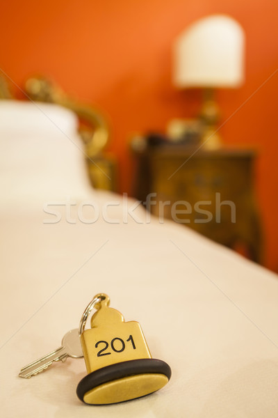 Hotel Room Key lying on Bed with keyring Stock photo © juniart