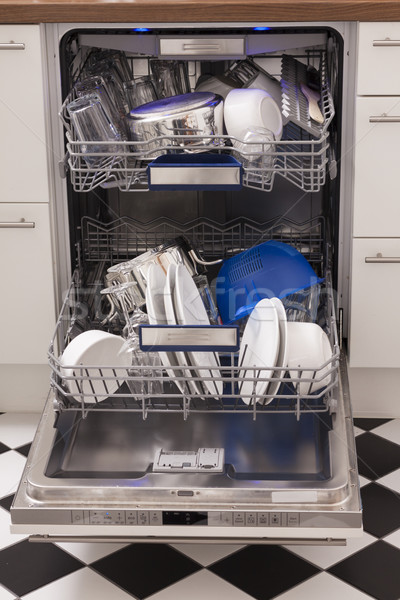 Dishwasher loades in a kitchen with clean dishes Stock photo © juniart