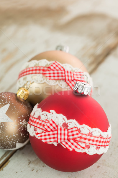 Three Christmas baubles on rustic wood Stock photo © juniart