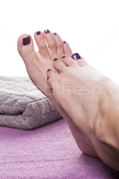 Bare feet with pedicure propped by towel Stock photo © juniart