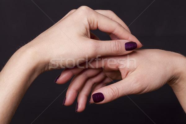 Feminino mãos preto decorado roxo Foto stock © juniart