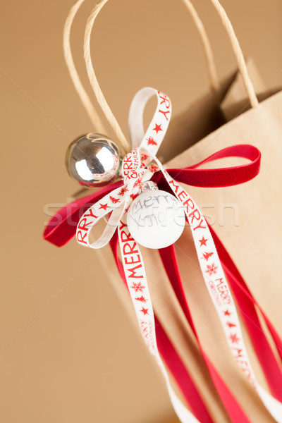 Stock photo: Gift bag with Merry Christmas ribbon