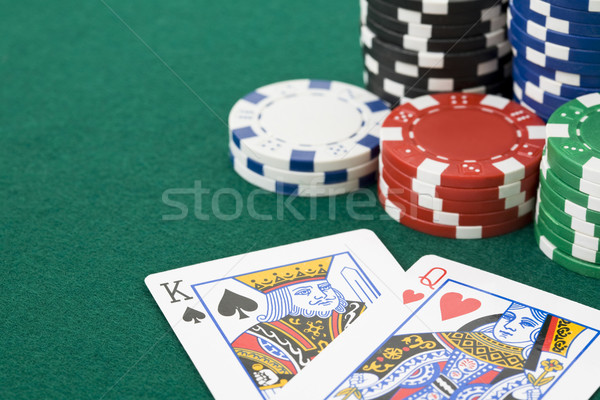 Stock photo: King and queen cards and poker chips