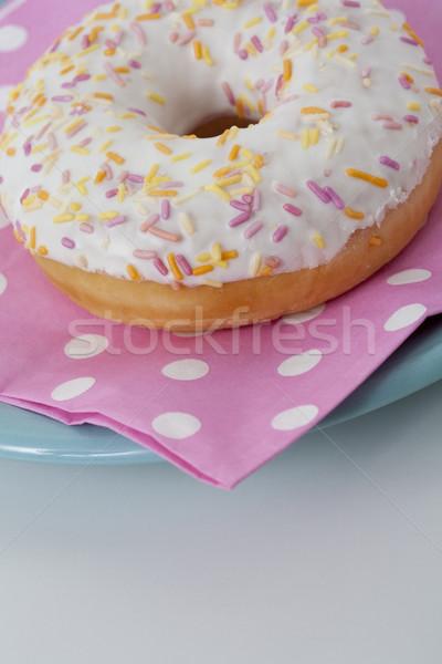 Donut with icing and sprinkles Stock photo © Kajura