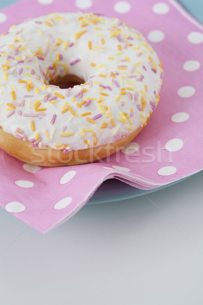 Donut with icing and sprinkles Stock photo © Kajura