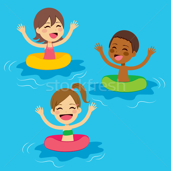 Stock photo: Kids Swimming With Floats