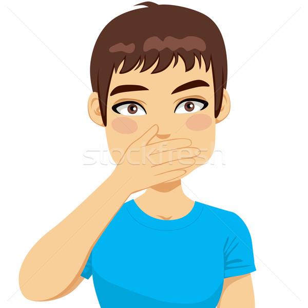 Férfi befogja száját kéz fiatalember póló egy Stock fotó © Kakigori