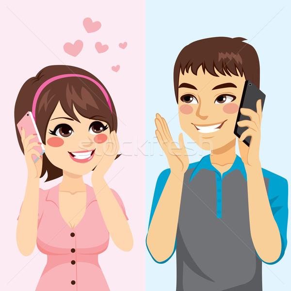 Szerelmespár beszél telefon aranyos fiatal nő Stock fotó © Kakigori