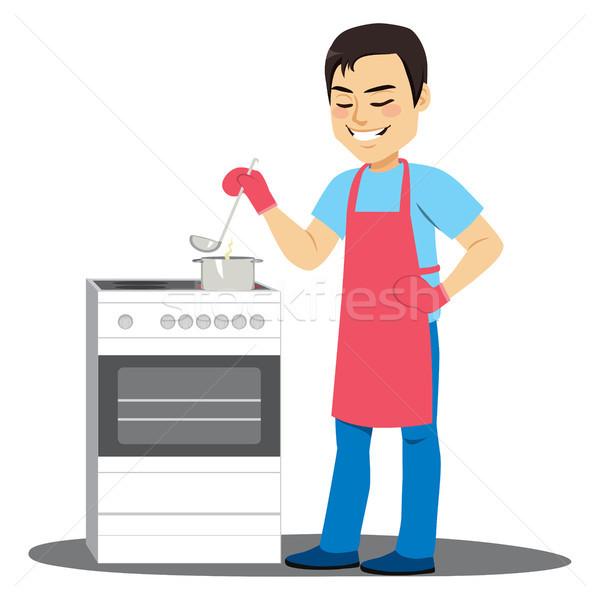 Man Cooking Soup Stock photo © Kakigori