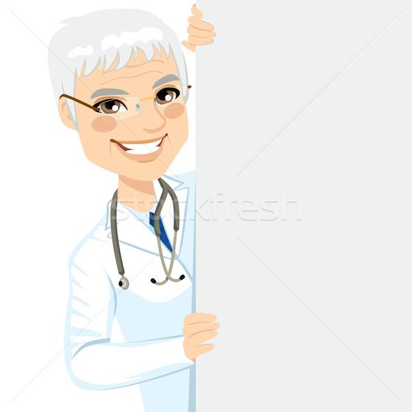 Senior Doctor Peeking Stock photo © Kakigori