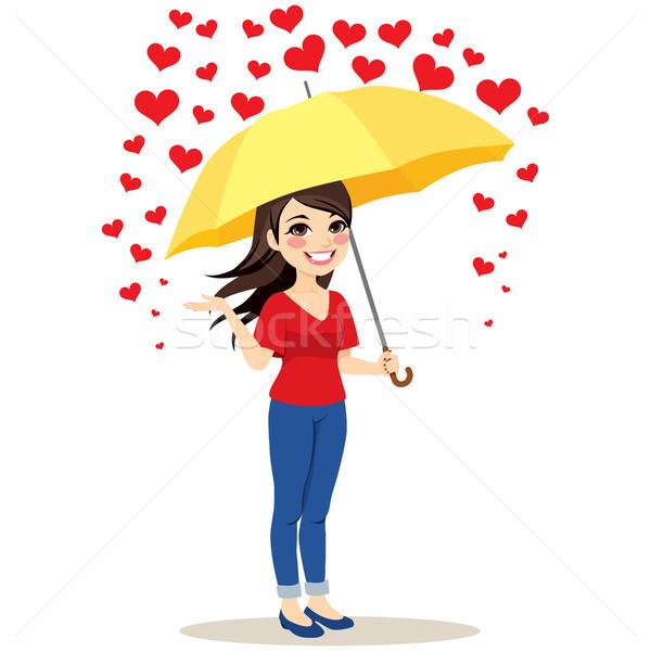 Esik az eső szívek esernyő gyönyörű fiatal nő citromsárga Stock fotó © Kakigori