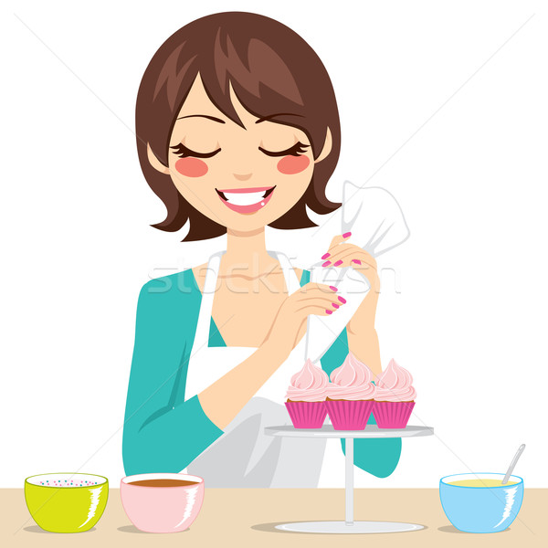 Woman Decorating Cupcakes Stock photo © Kakigori