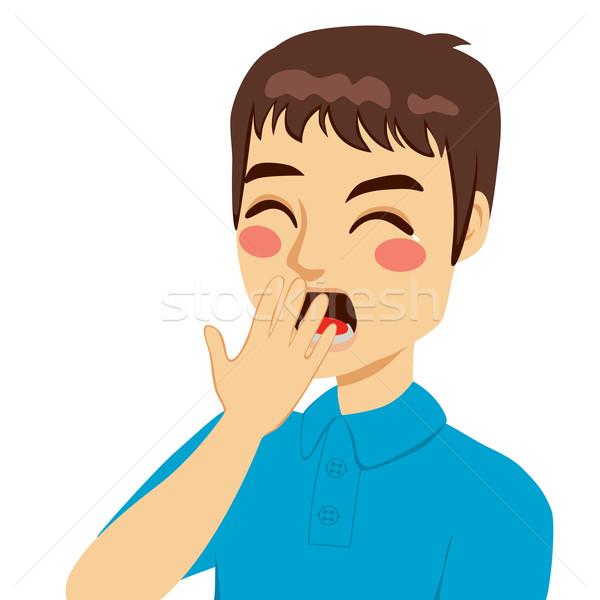 Fiatalember ásít befogja száját kéz csukott szemmel arc Stock fotó © Kakigori
