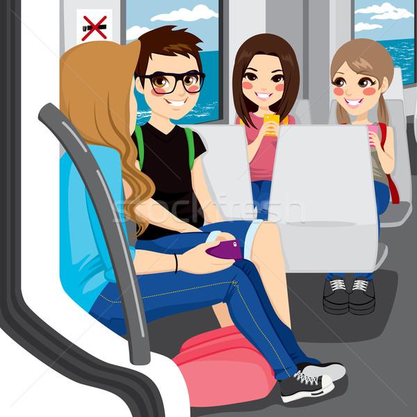 Tinédzserek ingázás vonat fiatal ül beszél Stock fotó © Kakigori