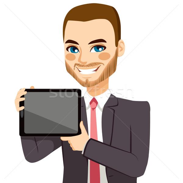 Businessman Displaying Tablet Stock photo © Kakigori