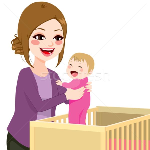 Mom Picking Baby From Crib Stock photo © Kakigori
