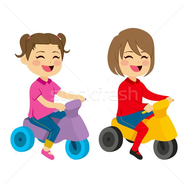 Kızlar üç tekerlekli bisiklet iki sevimli mutlu oynama Stok fotoğraf © Kakigori