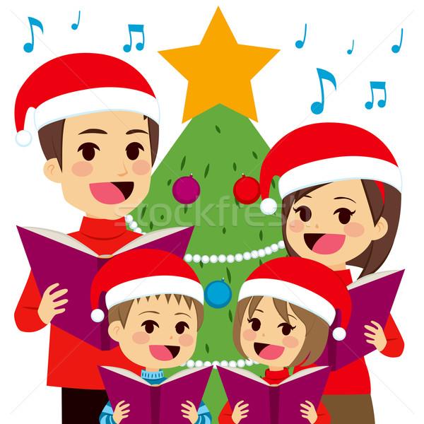 Family Singing Christmas Carols Stock photo © Kakigori