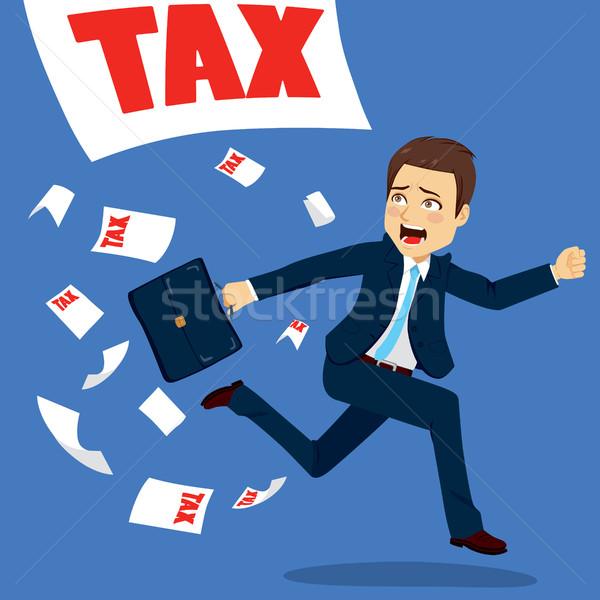 Businessman Running Of Tax Papers Stock photo © Kakigori
