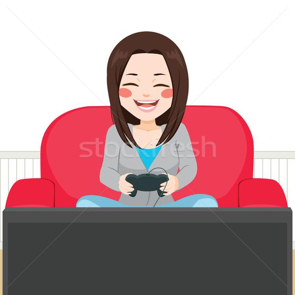 Fille jouer jeu vidéo cute adolescent séance Photo stock © Kakigori