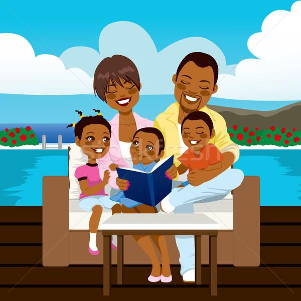 Felice african american famiglia lettura libro guardando Foto d'archivio © Kakigori