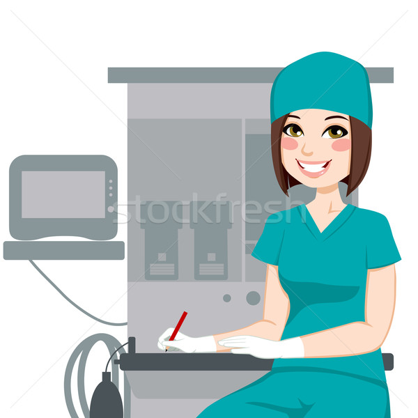 Female Nurse Writing Documents Stock photo © Kakigori
