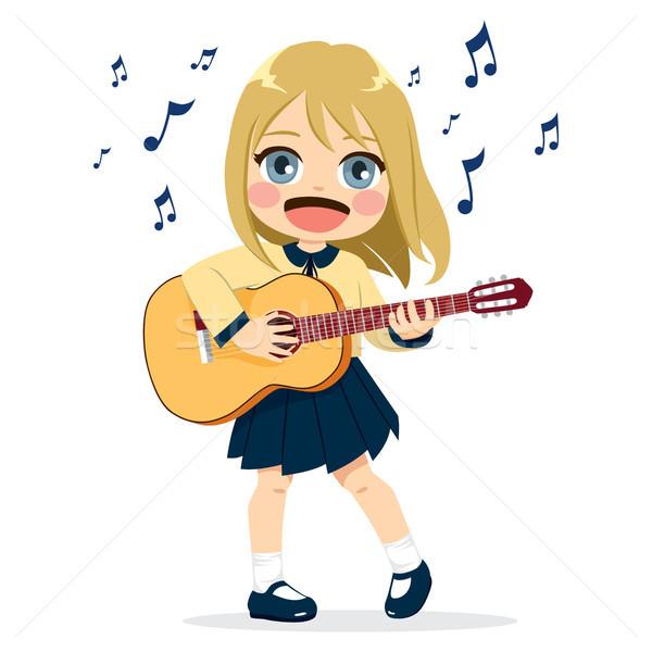 Lány játszik gitár aranyos kislány hangszer Stock fotó © Kakigori