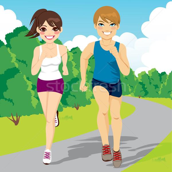 Jogging Couple Running In Park Stock photo © Kakigori