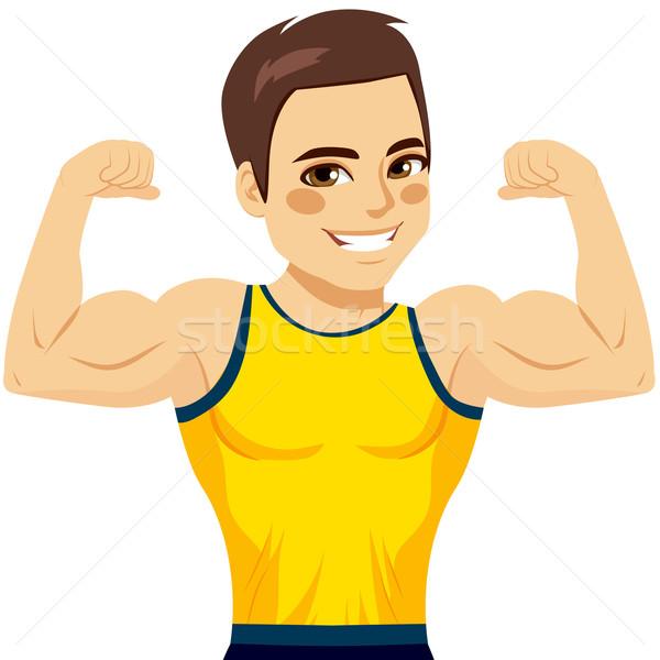Gespierd man biceps aantrekkelijk jonge glimlachend Stockfoto © Kakigori