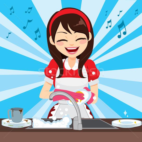 Housewife Washing Dishes Stock photo © Kakigori