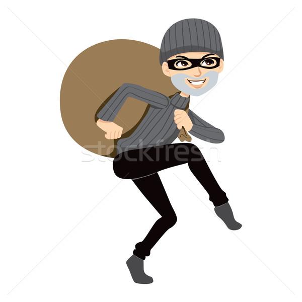 Feliz ladrón enorme bolsa robado Foto stock © Kakigori