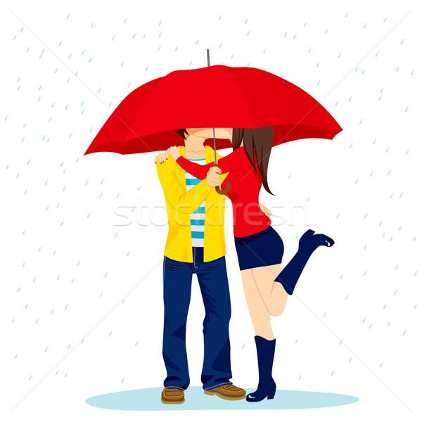 Hiding Kiss Under Umbrella Stock photo © Kakigori