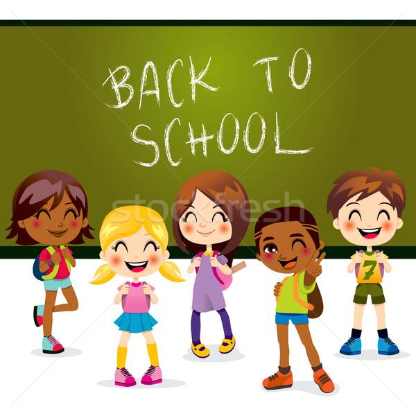 De volta à escola cinco crianças feliz em pé sala de aula Foto stock © Kakigori