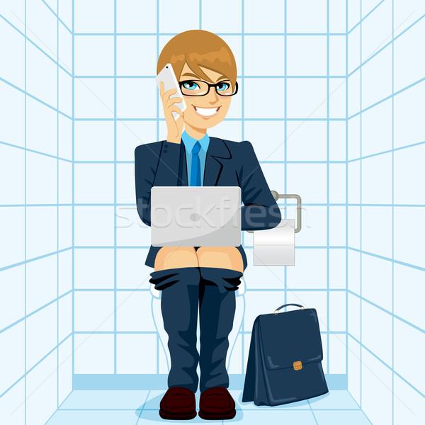 Workaholic Businessman Using Toilet Stock photo © Kakigori