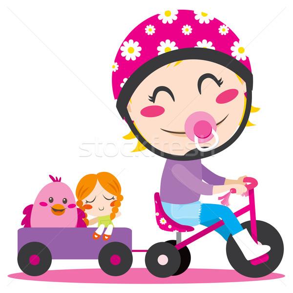 üç tekerlekli bisiklet tatlı küçük kız sürücü tok oyuncaklar Stok fotoğraf © Kakigori