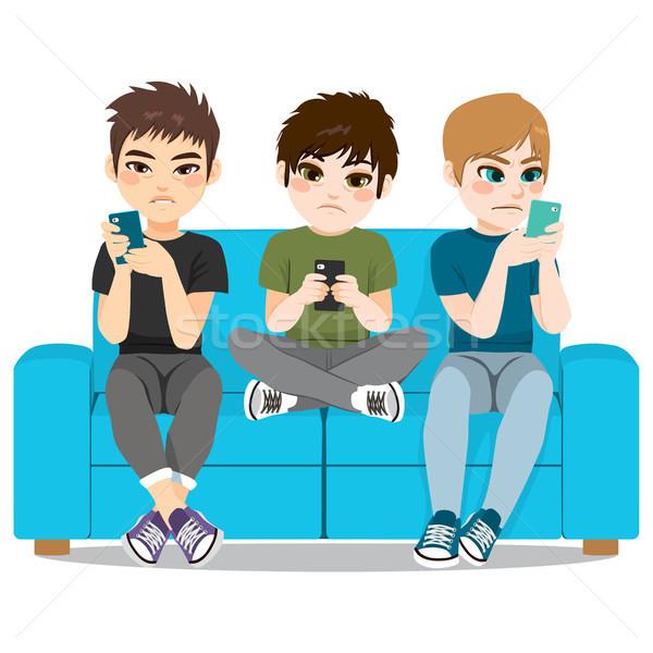 Smartphone dépendance mauvais mode de vie adolescent garçon Photo stock © Kakigori