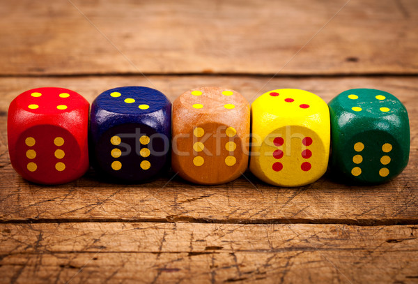 Wooden dices in line Stock photo © kalozzolak
