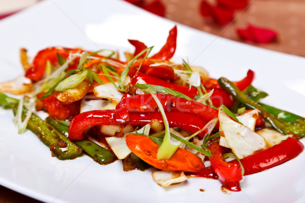 Oriental main course - Stir fried vegetables Stock photo © kalozzolak