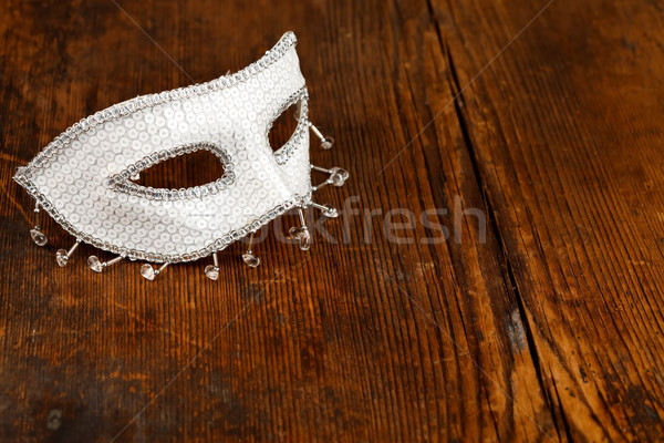Stock photo: White mask on wooden table