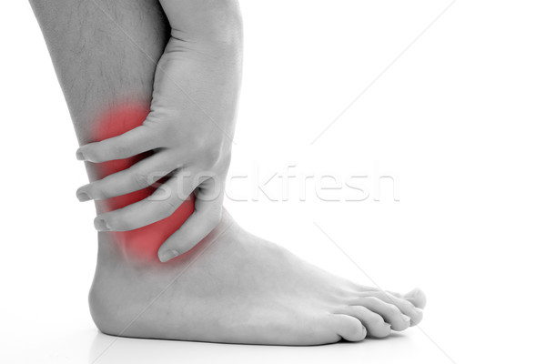 Ankle pain Stock photo © kalozzolak