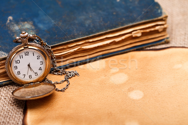 Pocket watch with antiquities Stock photo © kalozzolak
