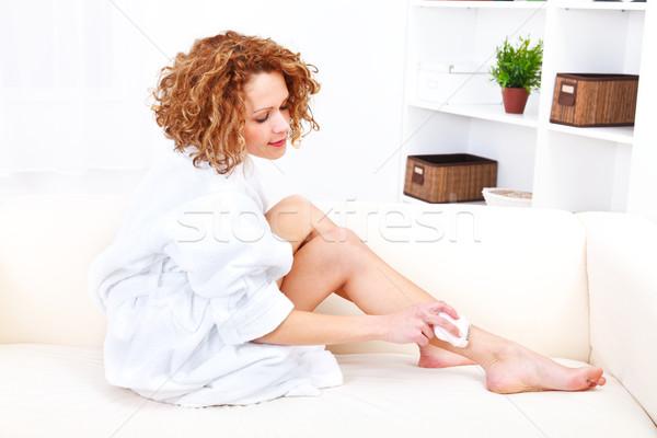 Beautiful woman shaving her legs with epilator Stock photo © kalozzolak