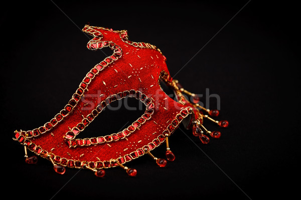 Stock photo: Red Venice mask isolated on black
