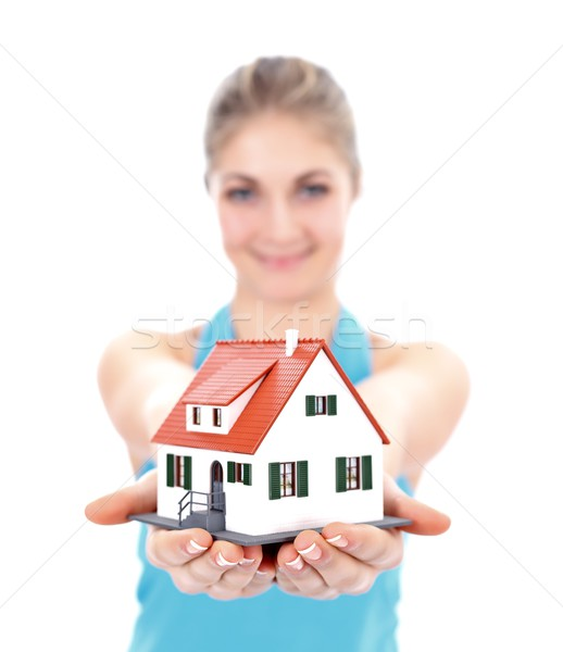 Girl with house in hand Stock photo © kalozzolak