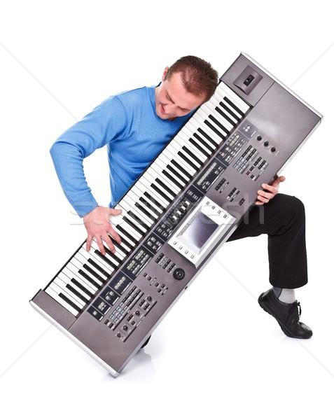 Hevesli klavye oyuncu genç diz oynama Stok fotoğraf © kalozzolak