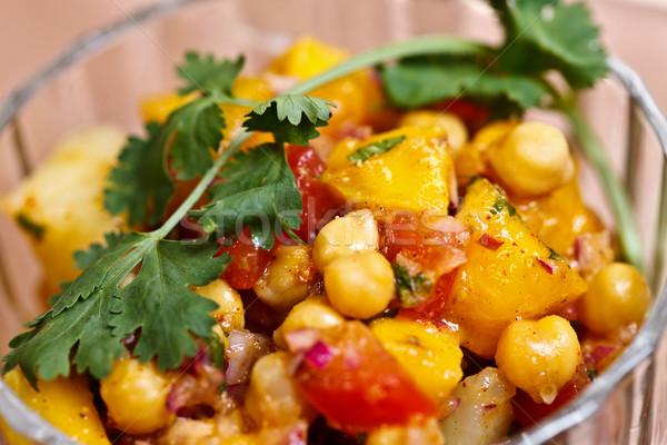 Asian food - Aloo Chana mango chat Stock photo © kalozzolak