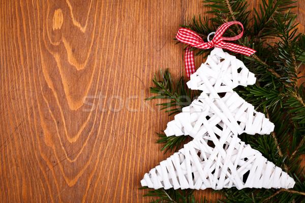 Little white Christmas tree on juniper leaves Stock photo © kalozzolak